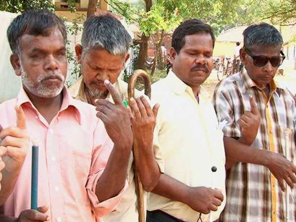 Blind Voters showing their ink-marked finger