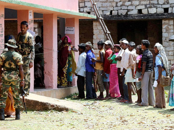 Voters wait to cast their votes for Lok Sabha elections