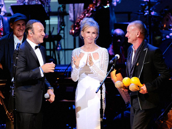 Actor Kevin Spacey, Trudie Styler and Sting perform together