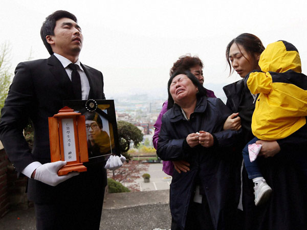 Families of the victims of the sunken ferry grieve