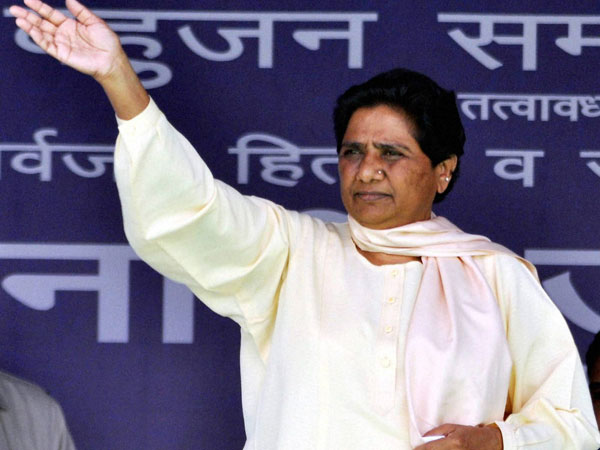 Mayawati waves to her supporters during an election rally