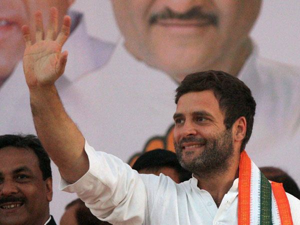 Rahul Gandhi waves during an election rally