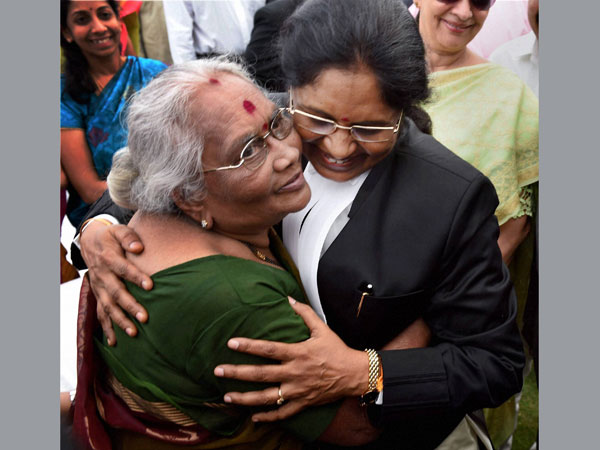 G. Rohini being greeted by her mother after taking oath in New Delhi