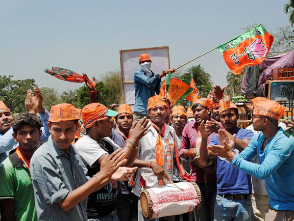 Supporters of BJP dance during an election campaign
