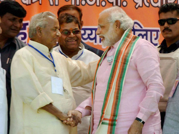 Narendra Modi shakes hands with party leader Kalyan Singh