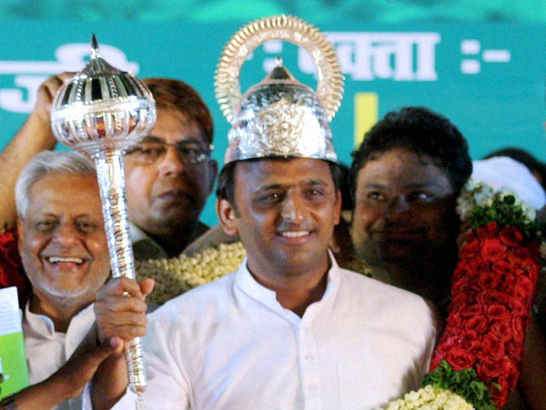 Akhilesh Yadav is presented a mace during an election rally