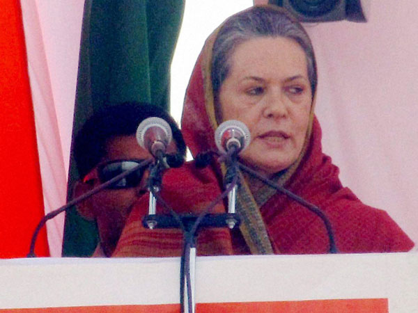 Sonia Gandhi addresses an election campaign rally