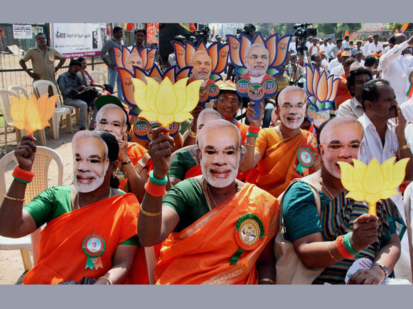 BJP supporters wear mask of Narendra Modi