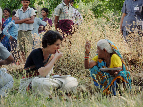 Priyanka Vadra shares meal with a village woman