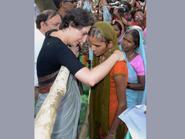 Priyanka Vadra consoles a girl during an election campaign