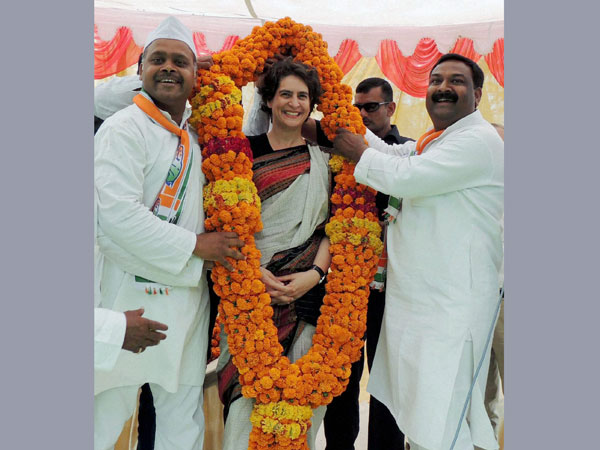 Priyanka Vadra is garlanded during an election campaign