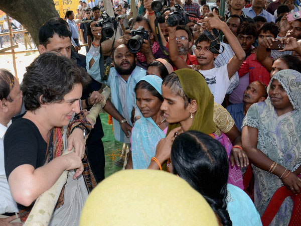 Priyanka Vadra interacts with women during an election campaign