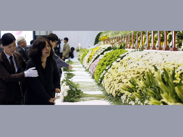 Relatives grieve for their loved ones