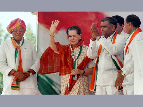 Sonia Gandhi waves during an election rally