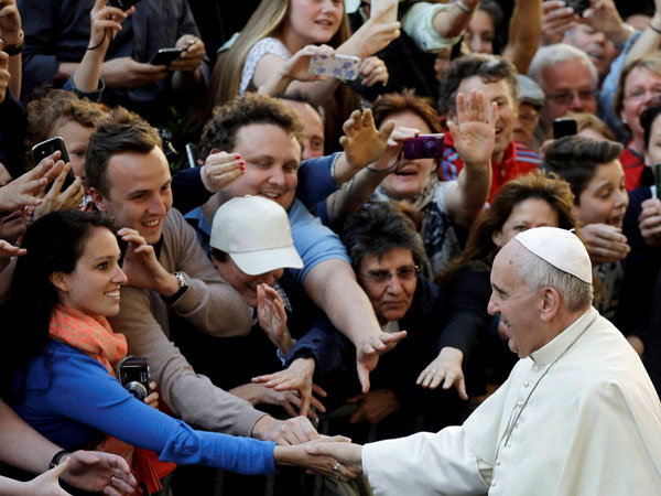 Pope Francis greets visitors
