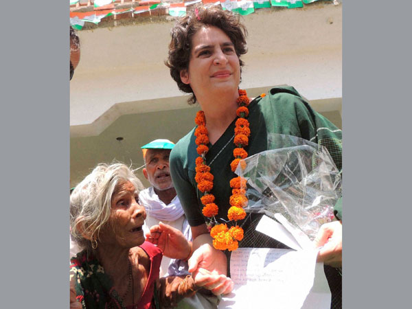 Priyanka Vadra interacts with an old age woman