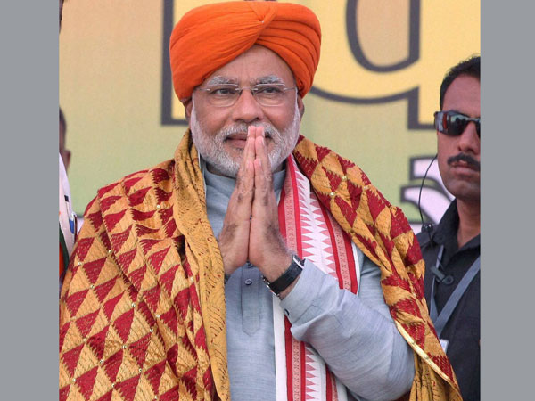 Narendra Modi is felicitated at an election rally