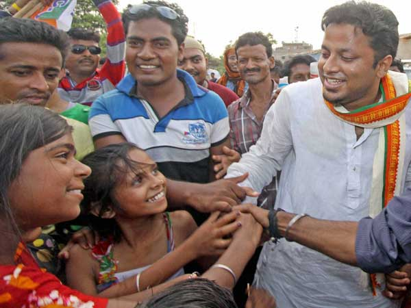Anupam Hazra meets with the villagers during his election campaign
