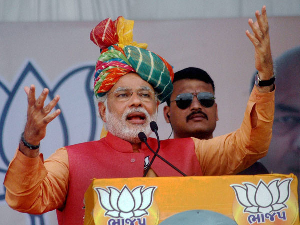 Narendra Modi addresses an election campaign rally in Anand