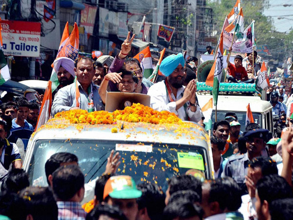 Singh Bajwa during an election roadshow in Pathankot