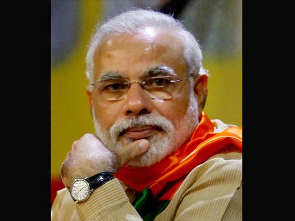 Modi votes, clicks selfie, attacks Cong