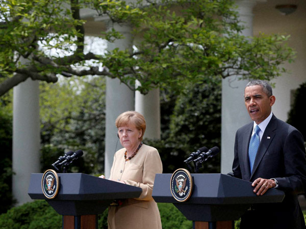 President Barack Obama and German Chancellor Angela Merkel participate in a joint news conference