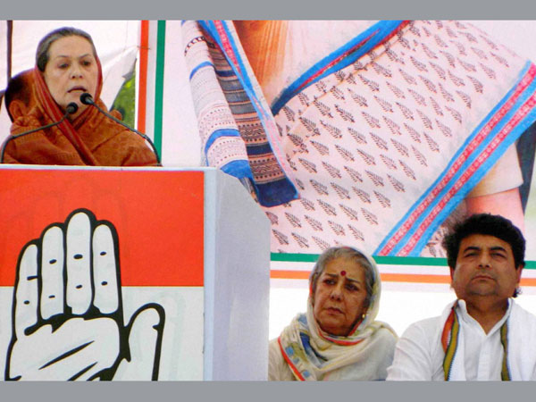 Sonia Gandhi addresses an election campaign at Padrauna