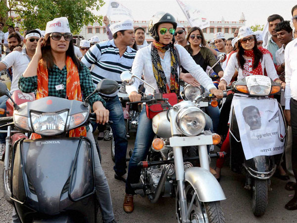 AAP leader Gul Panag rides bike (Bullet) during a road show
