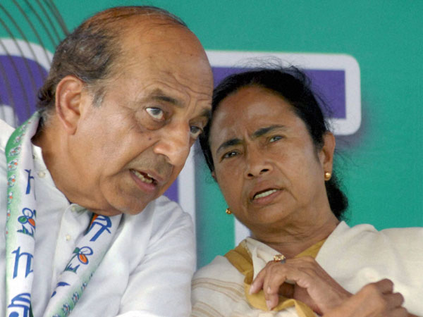 Mamata Banerjee with party candidate Dinesh Trivedi during an election campaign