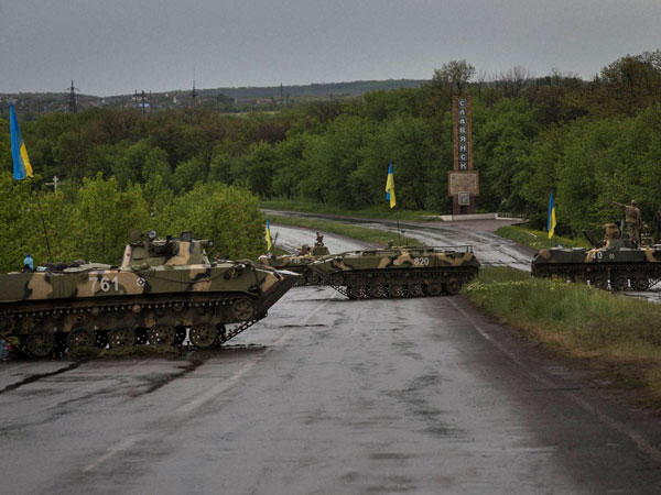 Armored vehicles man checkpoints in Ukraine