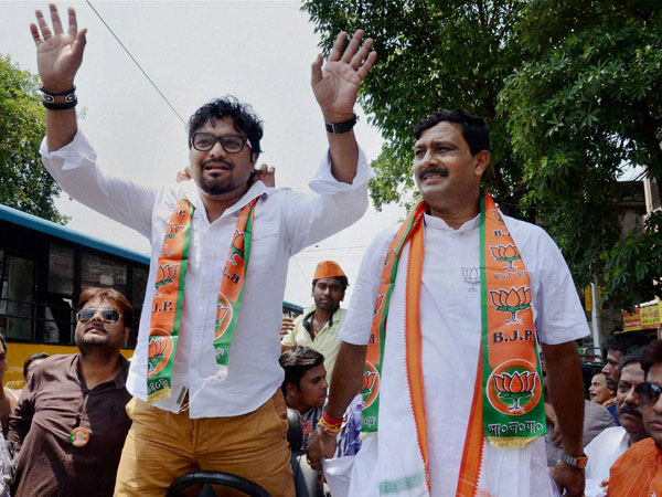 Singer Babul Supriyo waves during an election campaign