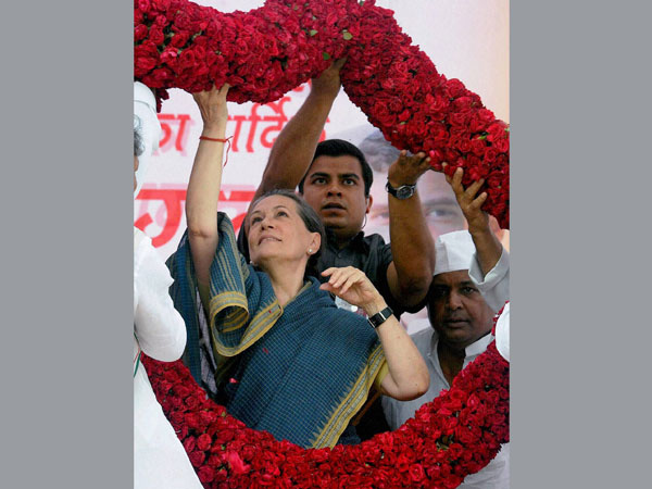 Sonia Gandhi is garlanded by supporters