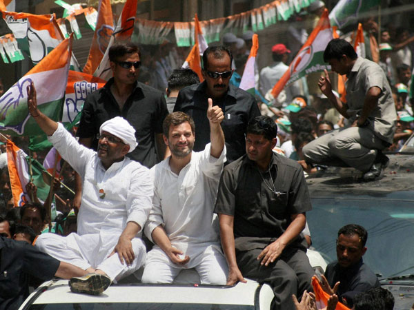 Rahul Gandhi waves to the crowd at a road show