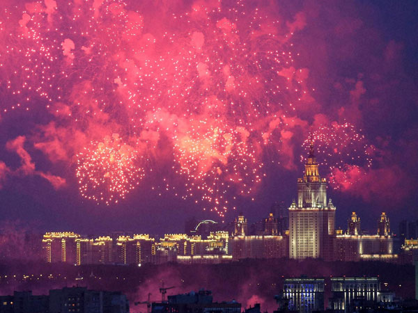 Fireworks explode over the city as it commemorates Victory Day