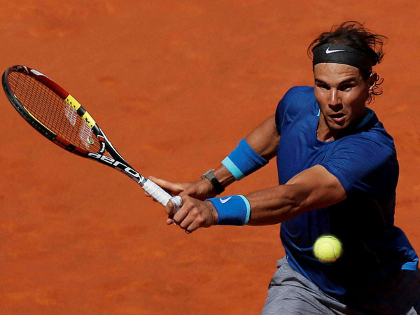 Rafael Nadal from Spain returns the ball during a Madrid Open tennis tournament