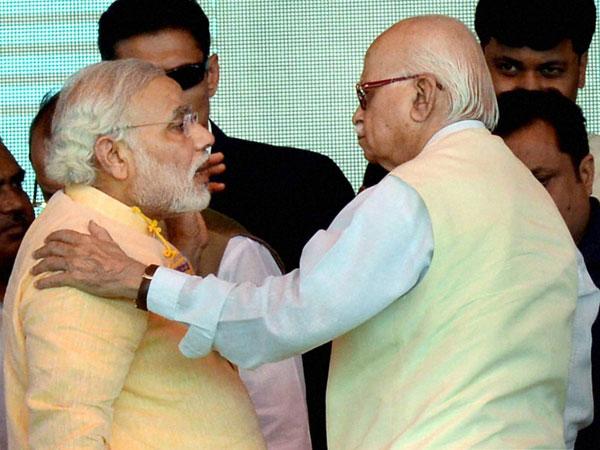 Advani welcomes Modi with a hug
