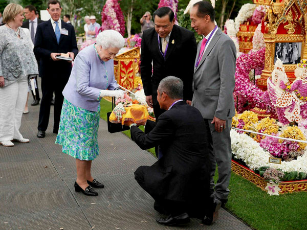 Britain's Queen Elizabeth II, centre, visits the Thai exhibit