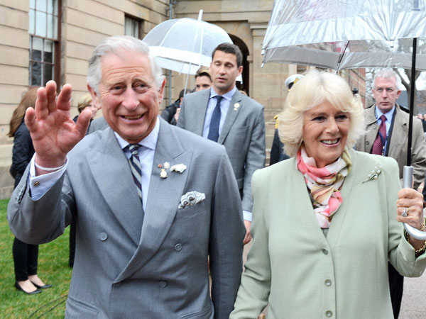 Prince Charles and his wife Camilla waves to supporters