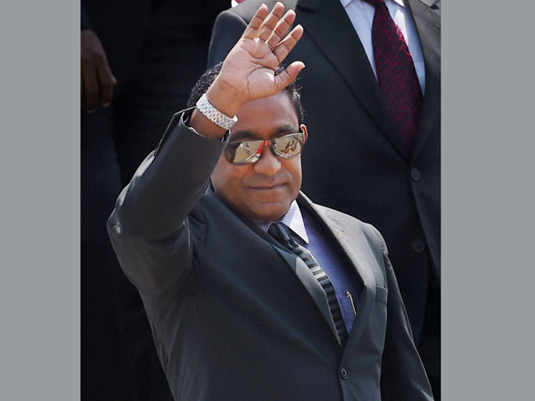 Maldives President Abdulla Yameen waves upon his arrival