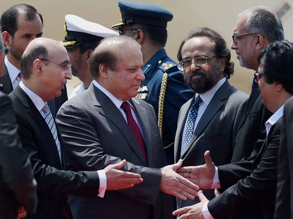 Pakistan's Prime Minister Nawaz Sharif is greeted