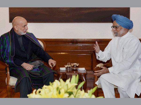 Koirala, Karzai meet Manmohan Singh