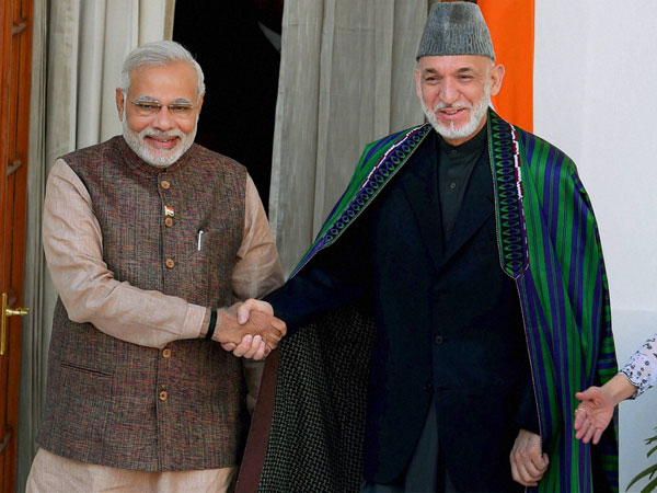Prime Minister Narendra Modi shakes hand with Afghan President Hamid Karzai