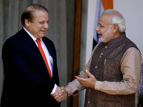 Prime Minister Narendra Modi, right, shakes hand with his Pakistani counterpart Nawaz Sharif