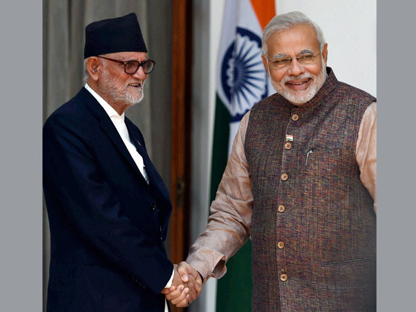 Prime Minister Narendra Modi shakes hands with his Nepali Counterpart Sushil Koirala
