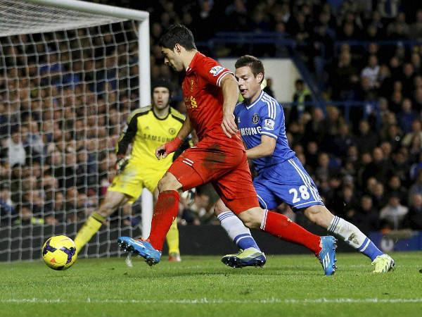 File photo: Suarez (left, in red)