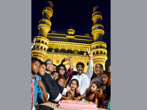 People celebrate Telangana formation day front of Historic Charminar