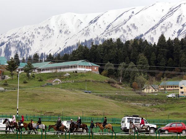Tourists enjoy themselves in Gulmarg of Jammu and Kashmir