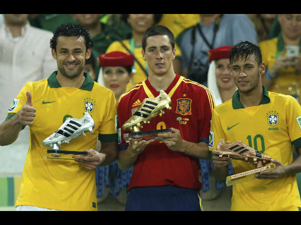 Golden boot winner Spain's Fernando Torres is flanked by silver boot winner Fred from Brazil, left, and bronze boot winner Neymar, right, after Brail won the soccer Confederations Cup final between Brazil and Spain at the Maracana stadium in Rio de Janeiro, Brazil, Sunday, June 30, 2013