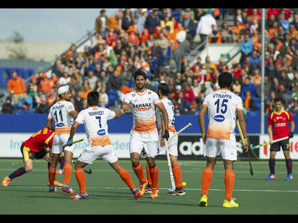 India's Rupinder Singh, centre, and his teammates celebrate after he scored via penalty stroke during their World Cup match against Spain in The Hague, Netherlands.