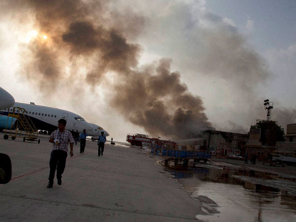 Smoke rises above the Jinnah International Airport